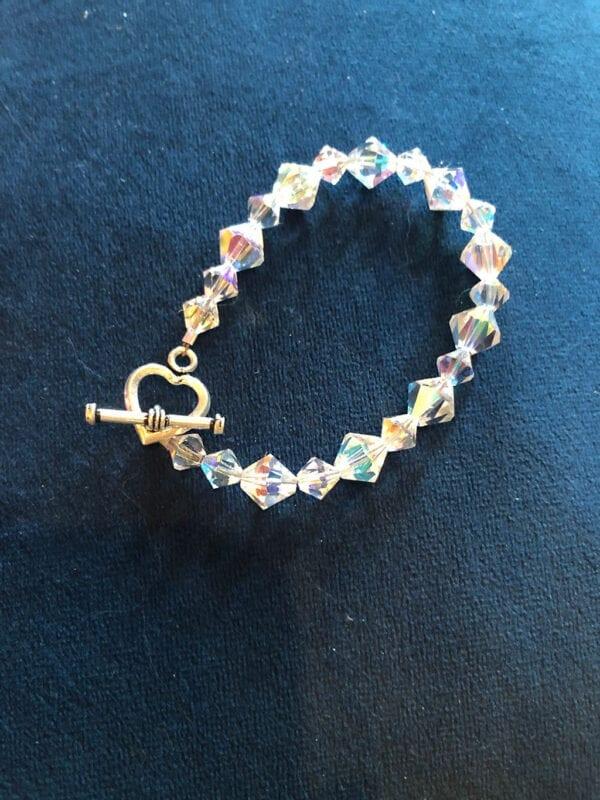 Colorful Swarovski crystal bracelet on blue cloth