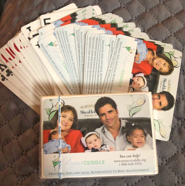 Deck of cards with a photo of a family at the back (600 x 603)